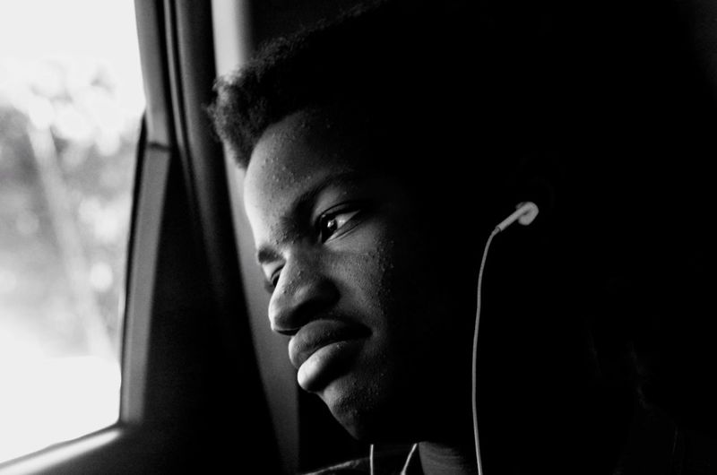 Looking Through Window One Person Headshot Close-up Young Adult 13-16 Listening To Music Earphones Male Teen Portrait Teen Life Teenage Boys Teenager Monochrome Photography