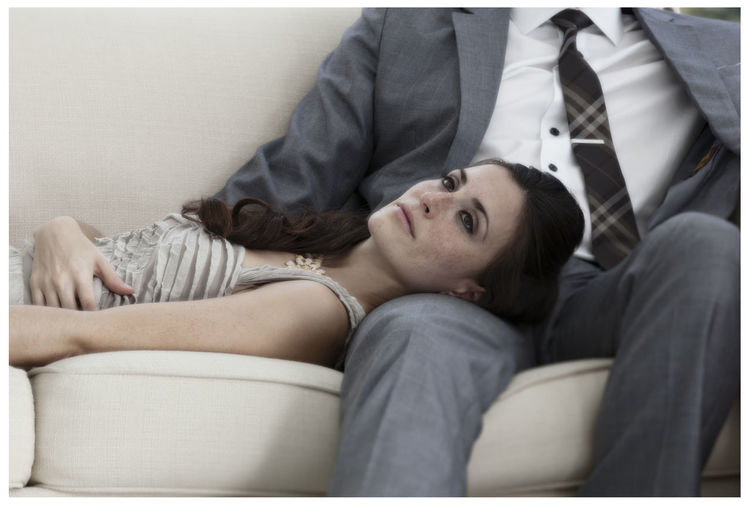 Woman lying on lap at home