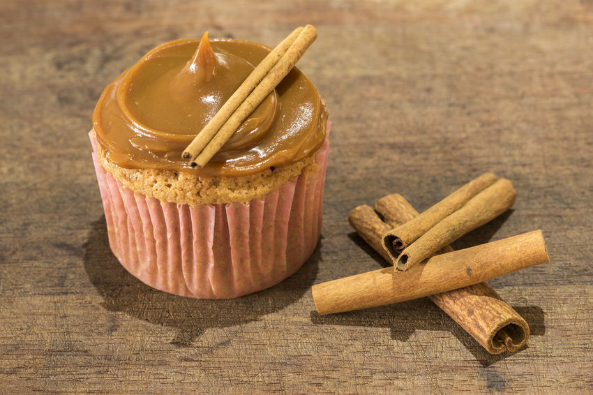 homemade cinnamon cupcake with milk jam on wooden board - horizontal Cupcakes Homemade Baked Cupcake Cynamon Muffin Muffins Sweet Sweet Food