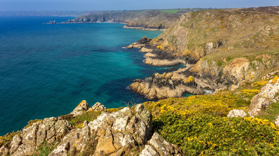 Walking the Southwest coast path Beauty In Nature Cliff Cornish Coast Cornwall Life Cornwall Tourism Cornwall Uk Coverack Day Kernow Mountain Nature No People Outdoors Physical Geography Rock - Object Rock Formation Rocky Coastline Scenics Sea Seascape Sky Tranquil Scene Tranquility Water