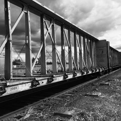 Freight train against cloudy sky