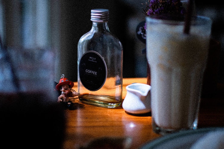 Coffee Table Bottle Container Indoors  Refreshment Food And Drink Communication Drink Still Life Close-up No People Text Glass - Material Western Script Technology Transparent Jar Selective Focus Food Focus On Foreground