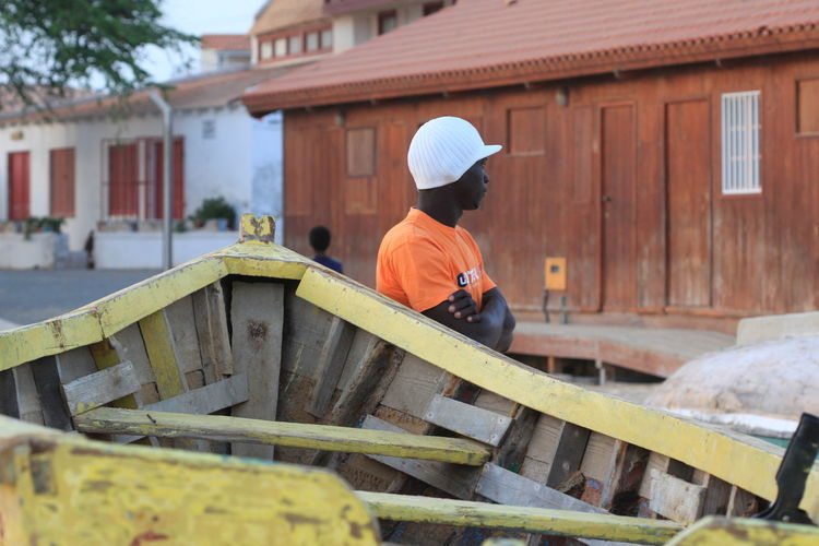 Adult Brown Background Building Exterior Capo Verde Day Orange T-shirt Outdoors Sal Island Santa Maria Summer 2015 White Cap Yellow Boat