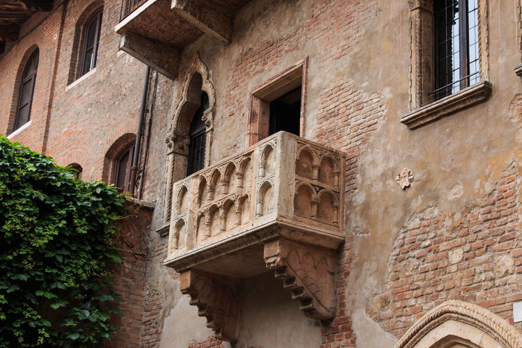 Juliet's balcony - Verona - Italy Architecture Arena Building Building Exterior Built Structure City Coluseum Day Historic History Italy Low Angle View No People Outdoors Repetition Residential Building Romeo And Juliet Verona Weathered Window