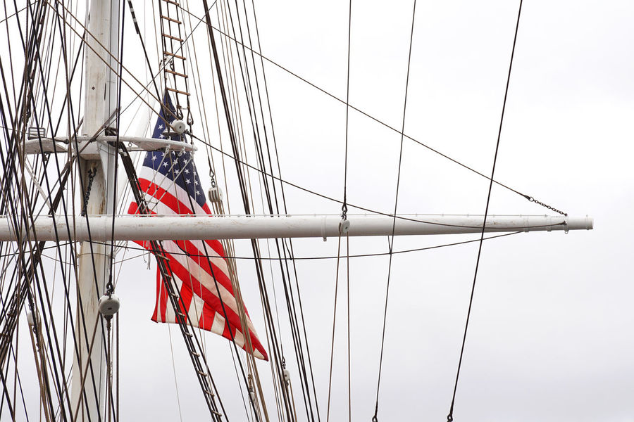 Rigging of a Sailing Ship with Stars and Stripes America American Flag At Anchor Banner Cloudy Flag Harbour Maritime Maritime Photography Nautical Nautical Vessel Naval New York City Overcast Rig Rigging Rope Sailing Sailing Ship Stars And Stripes Flag USA Wind Windy Yard Yardarm
