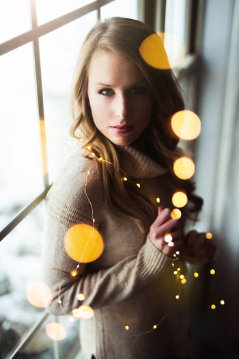 Christmas Lights Beautiful Woman Close-up Day Illuminated Indoors  Looking At Camera One Person People Portrait Real People Window Light Young Adult Young Women