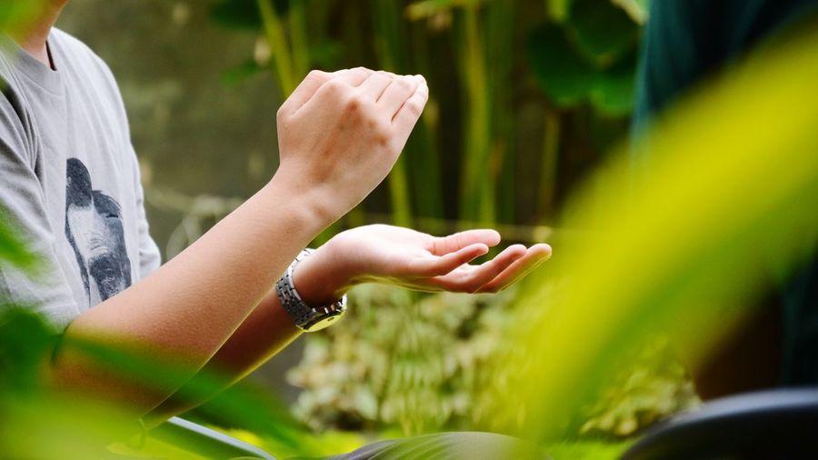 Hand gesture of explaining something.