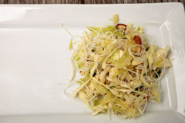 Healthy Asian cabbage, rice pasta and almond salad on a white plate Asian  SLAW Almond Slivers Almonds Cabbage Close-up Day Food Food And Drink Freshness Healthy Eating Healthy Food Healthy Lifestyle Indoors  No People Raw Food Ready-to-eat Rice Noodles