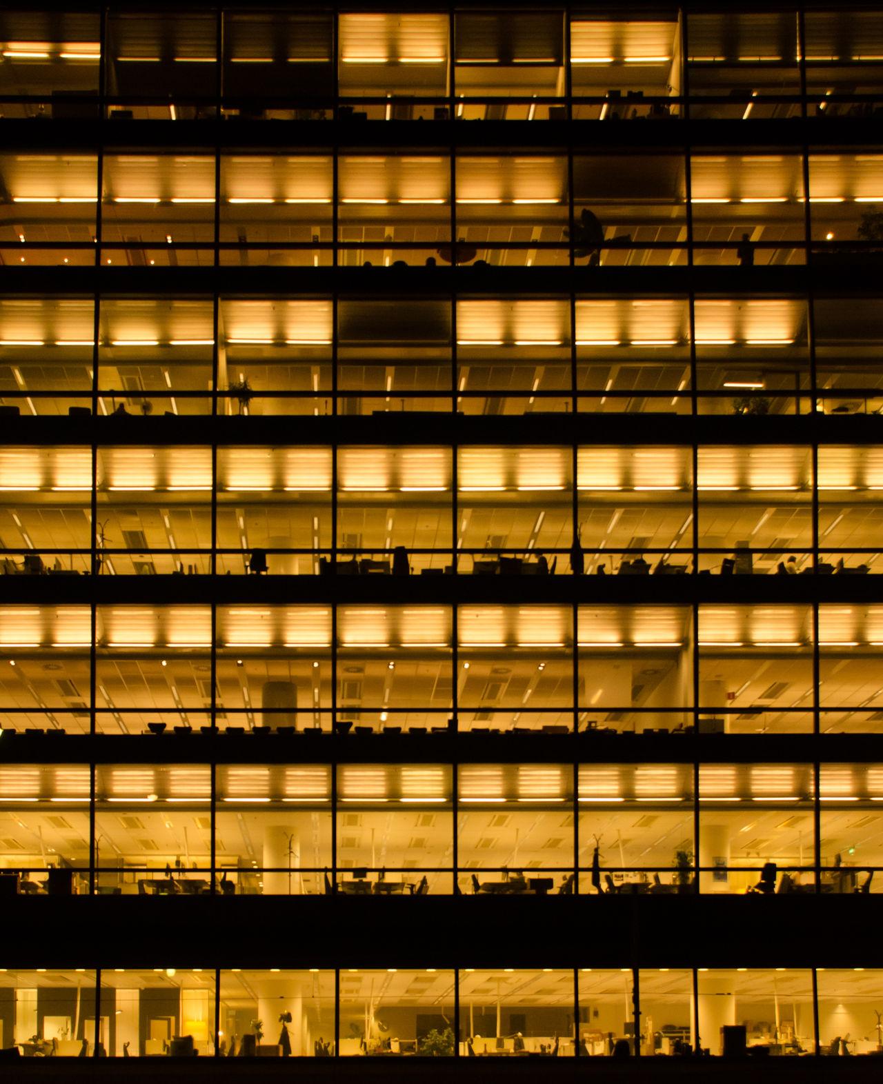 Full frame shot of illuminated office building