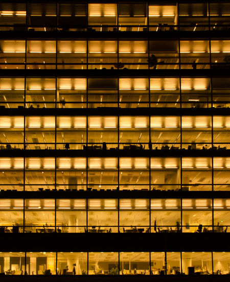 Full frame shot of illuminated office building