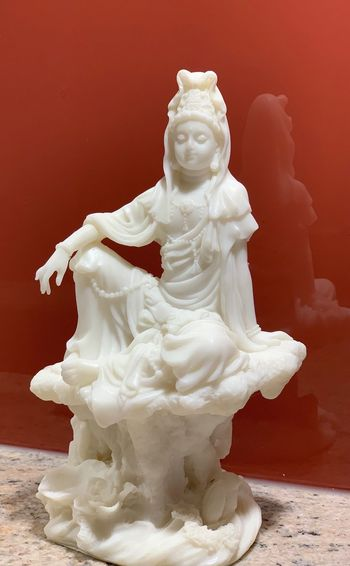 Close-up of statue against red background