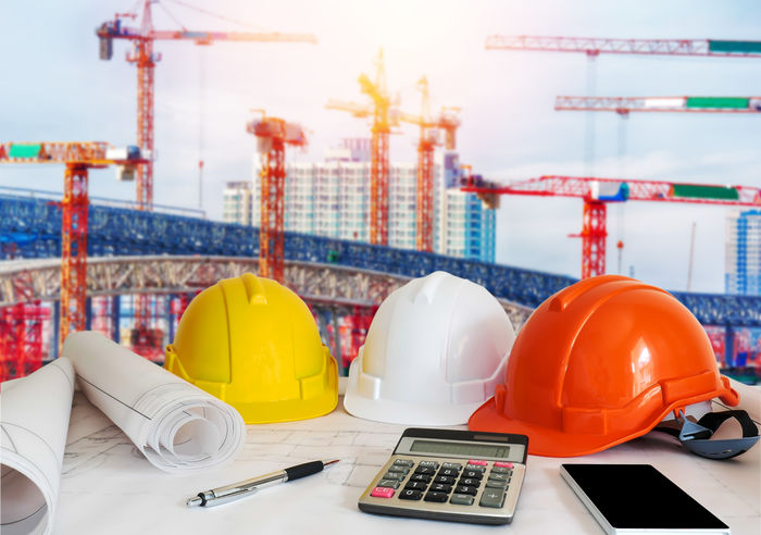 Construction Site Architecture Blue Prints Building Exterior Business Concept Business Construction Calculator Concept Crane Finance Hardhat  Headwear Helmet Pen Technology