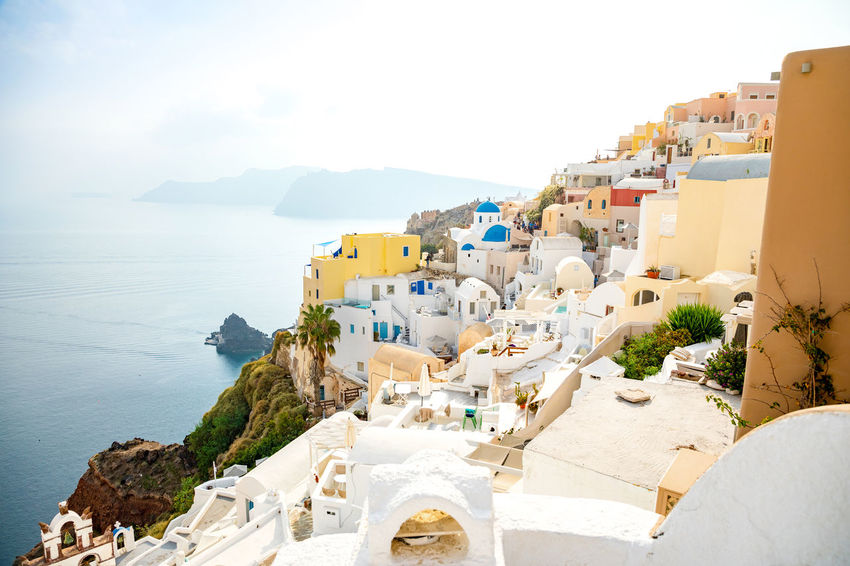 Greece Santorini Island Architecture Building Exterior Built Structure Sky Water Building Sea Mountain Nature City Day Residential District No People High Angle View Town Travel Destinations Whitewashed Religion Outdoors TOWNSCAPE