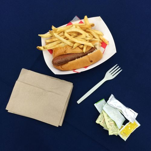 Hot Dog And French Fries On Table