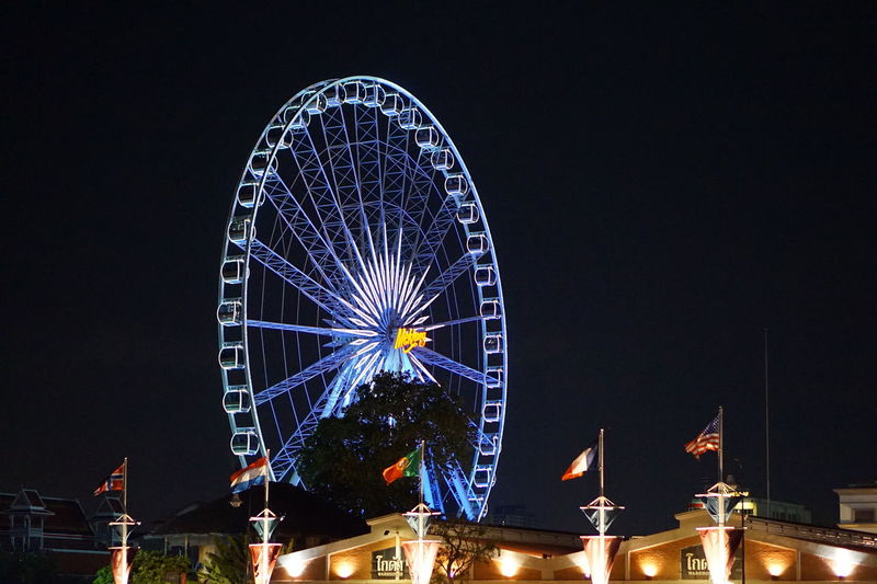 Ferris Wheel Night Illuminated Arts Culture And Entertainment Wheel Amusement Park Sky Amusement Park Ride Motion Outdoors No People Big Wheel River River At Night Chaopraya River Chaopraya River At Night Asiatique The Riverfront Bangkok Thailand Adapted To The City