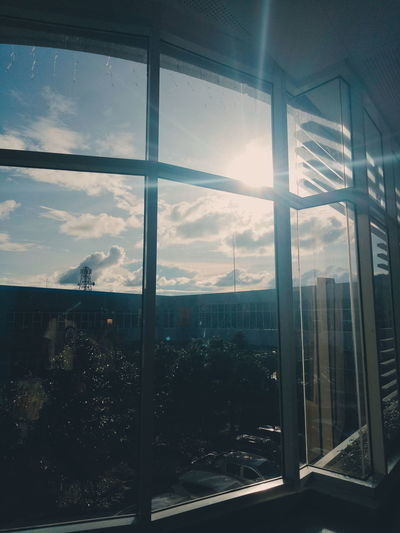 Sun's Finally Out Today. Window Cloud - Sky Skyscraper Sky Indoors  Architecture Sunset Looking Through Window Cityscape Day Modern Building Exterior City Apartment No People Urban Skyline