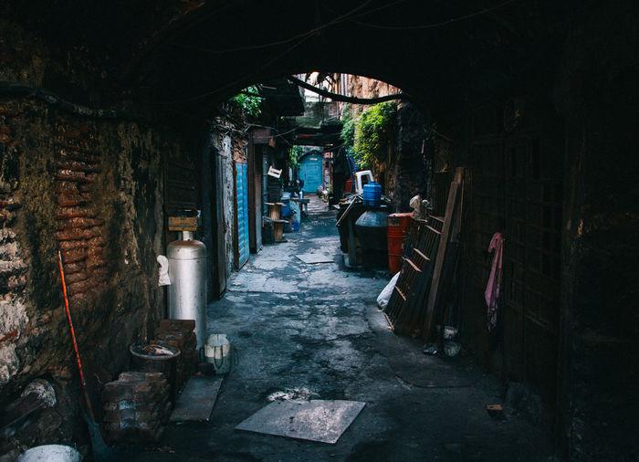 Empty footpath amidst slums