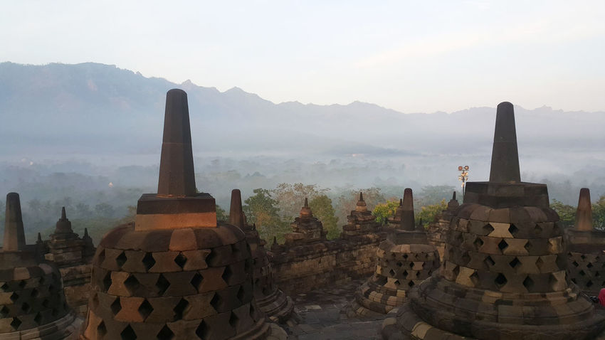 morning at borobudur temple Borobudur Borobudur Temple Ancient Ancient Civilization Architecture Beauty In Nature Building Exterior Built Structure Day Fog History Mountain Mountain Range Nature No People Old Ruin Outdoors Place Of Worship Religion Scenics Sky Spirituality Sunset Travel Travel Destinations