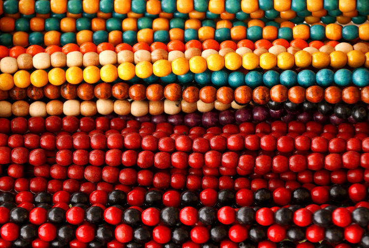 Full frame shot of colorful beads for sale at market
