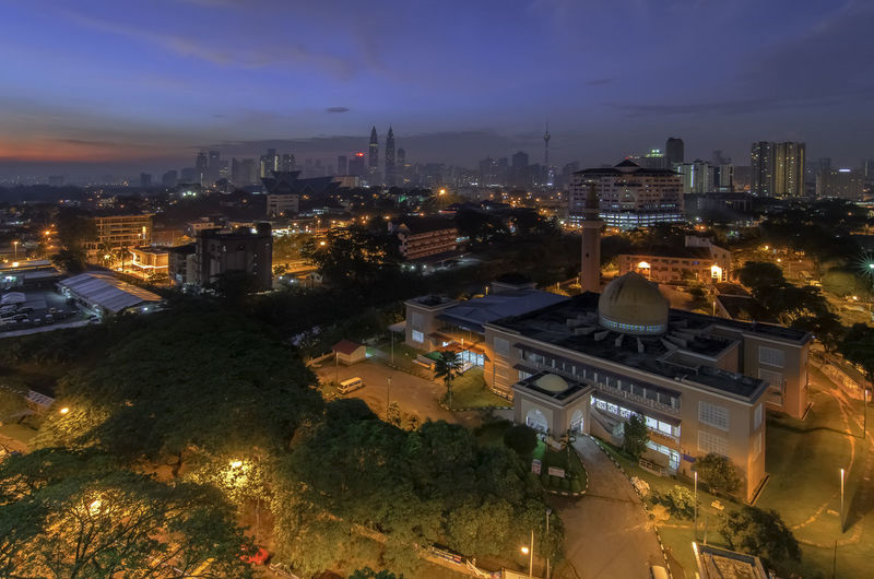 High angle view of mosque in city against sky during sunrise