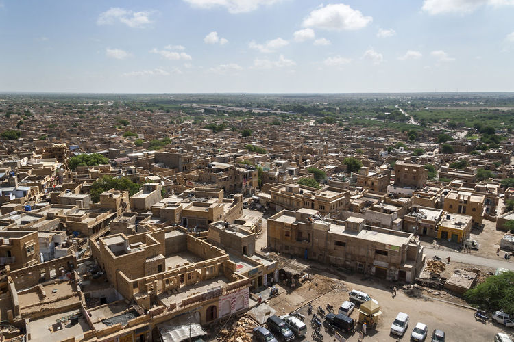 Jaisalmer 02 Cityscape Cloudy Sky Panoramic View Skyline The Golden City Tourist Attraction  UNESCO World Heritage Site Urban Exploration Urbanscape Architecture Building Exterior Built Structure Elevated View Famous Place High Angle View Jaisalmer Jaisalmer Fort Outdoors Rajasthan Sandstone Scenic View Sunny Day Tourism Travel Destination Viewpoint