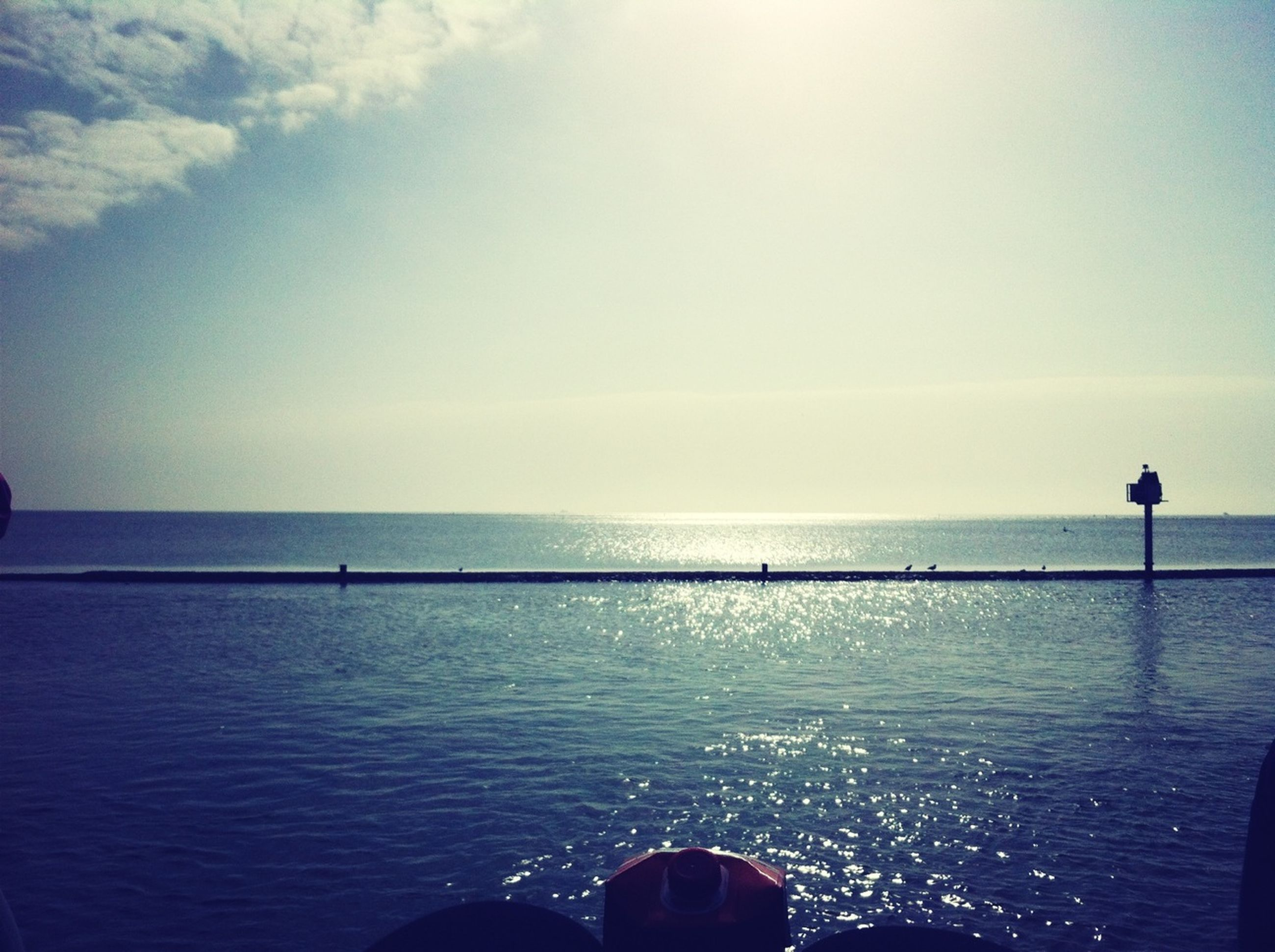 sea, horizon over water, water, scenics, tranquil scene, tranquility, sky, beauty in nature, copy space, lifestyles, nature, men, leisure activity, clear sky, unrecognizable person, idyllic, standing, rippled