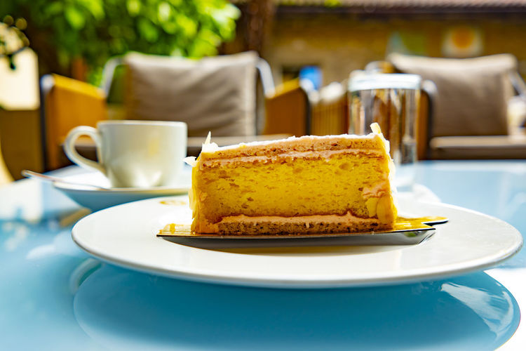 Lemon Cake and Cappuccino Coffee Low Angle View Baked Cake Cappuccino Close-up Coffe Break  Coffee - Drink Coffee Cup Cup Dessert Drink Focus On Foreground Food Food And Drink Freshness Indulgence Lemon Cake No People Plate Ready-to-eat Serving Size Still Life Sweet Food Table Temptation