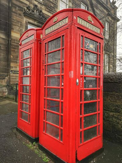 Pay Phone Telephone Booth Telephone Red Old-fashioned Communication Text Close-up Architecture Built Structure
