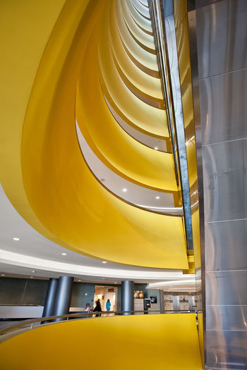 Architectural Column Architectural Feature Architecture Building Built Structure Conventioncenter Day Escalator Illuminated In A Row Interior Las Vegas Low Angle View Modern No People Repetition Spiral Yellow