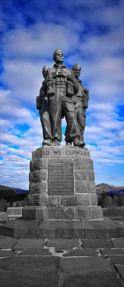 TheCommando Memorialis amonument inLochaber, Scotland, dedicated to the men of the originalBritish Commando Forcesraised duringWorld War II. Situated around a mile fromSpean Bridge, it overlooks the training areas of the Commando Training Depot established in 1942 atAchnacarry Castle Malephotographerofthemonth Scotland Commando Memorial Sculpture Statue Monument Representing Human Representation Art And Craft Male Likeness Sky Cloud - Sky Architecture War Memorial Memorial