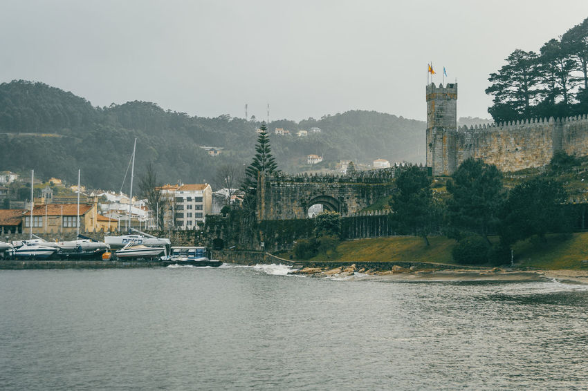 Baiona Castle Galicia SPAIN Wall Architecture Bridge - Man Made Structure Building Exterior Built Structure City Connection Day Fortification Mountain Nature Nautical Vessel No People Outdoors River Sky Transportation Travel Destinations Tree Water Waterfront