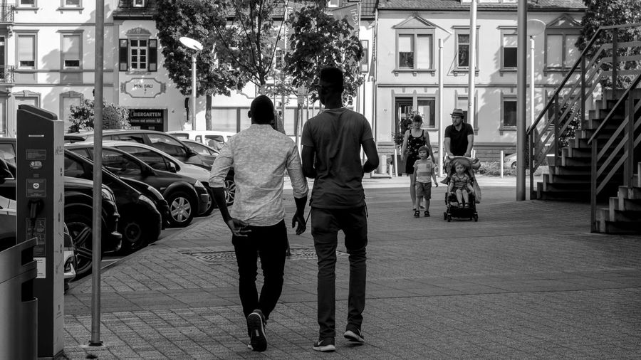 Black & White Street Photography Monochrome The Devil's In The Detail Sidewalk Urban Perspectives Black And White Rear View Architecture City Building Exterior Walking Real People Men Built Structure Street Lifestyles Motor Vehicle Car Full Length Land Vehicle Adult Two People Footpath Women Outdoors Couple - Relationship The Way Forward The Street Photographer - 2019 EyeEm Awards