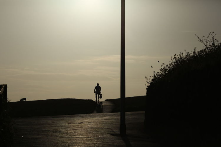 Man walking along the cliff tops at Fisherman's Walk as sunset approaches. Out Walking Light And Shadow Soaking Up The Sun