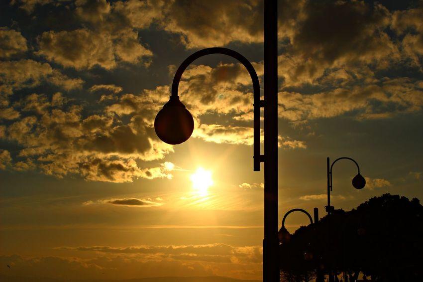 Italy, Umbria: Street lamps in sunset. Beautiful Business Holidays Perugia Road Trasimeno Lake Wonderful Cloud - Sky Clouds Evening Fine Horizon Italy Lake Nature Nice Orange Color Passignano Sky Sunset Trasimeno Travel Destinations Umbria Water Yellow