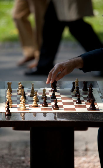 Chess move. Gambit  Strategy Game Thinking Winning Board Game Checker Checkered Pattern Chess Chess Board Chess Figures Chess Piece Chess Set Chesspieces Focus On Foreground Game Human Hand Leisure Activity Leisure Games Move Pieces Playing Real People Strategy Success