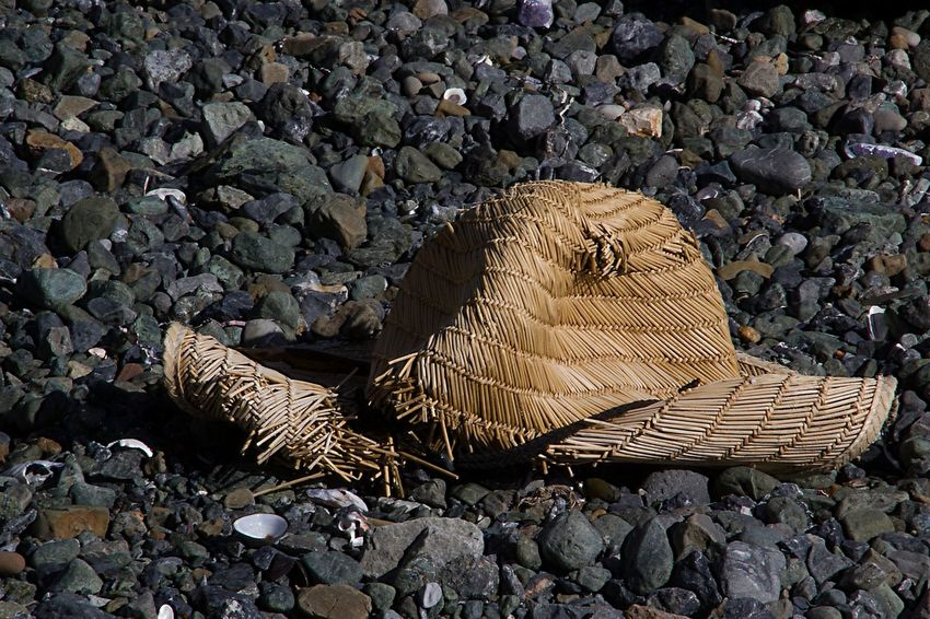 No People Outdoors Nature Day Straw Hat Beach Beach Trash Lost Lost Hat Rocky Beach