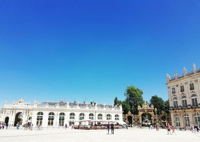 NANCY, FRANCE- JUNE 23, 2018 : Famous Stanislas square in Nancy old Town during summer with people in square Landmark Blue Blue Sky Summer Travel Destinations Travel Europe Stanislas Square Famous Place people and places Walking Around Cityscape City Landscape Outdoors Square Urban King - Royal Person City Ancient Civilization Clear Sky Sculpture Royalty History Blue Ancient Sky Monument Palace Statue