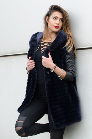 fashion clothing autumn winter One Person Young Adult Beauty Wall - Building Feature Hair Young Women Front View Beautiful Woman Women Hairstyle Looking At Camera Clothing Long Hair Adult Portrait Three Quarter Length Lifestyles Indoors  Fashion Leather Warm Clothing