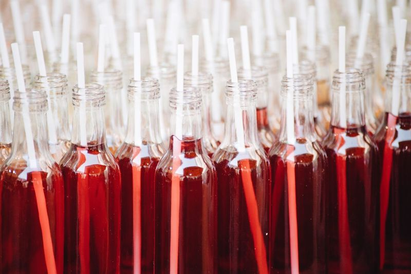 close-up drinks in small bottles Red No People Close-up Indoors  Large Group Of Objects Still Life Side By Side Container Burning Glass - Material Abundance In A Row Backgrounds Focus On Foreground Strawberry Food And Drink Full Frame Berry Fruit Incense Cold Temperature