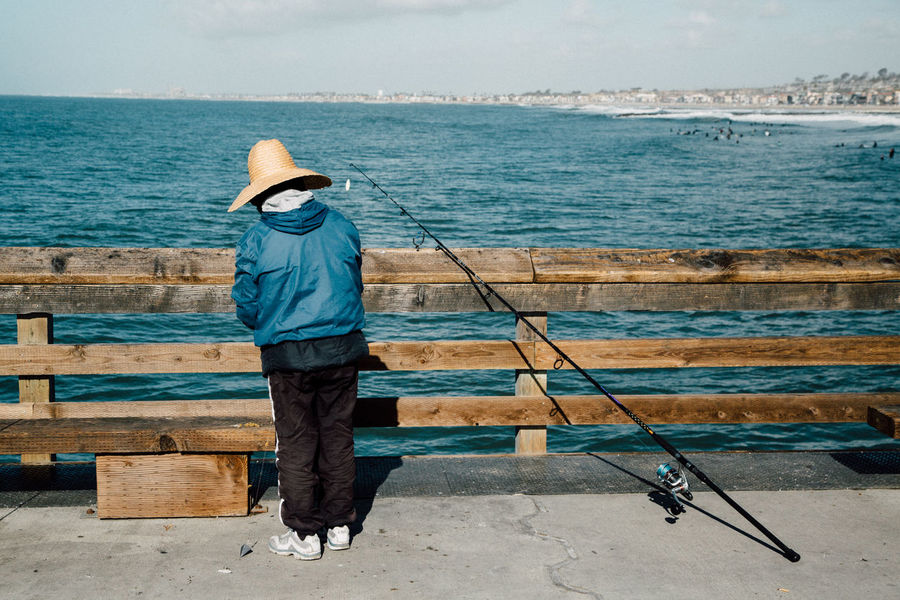 angled Angle California California Coast California Love Fish Fisherman Fishing Hobbies Leisure Activity Lifestyles Men Outdoors Pier Portrait Real People Rear View Sea View Seascape Showcase: January Weekend Activities