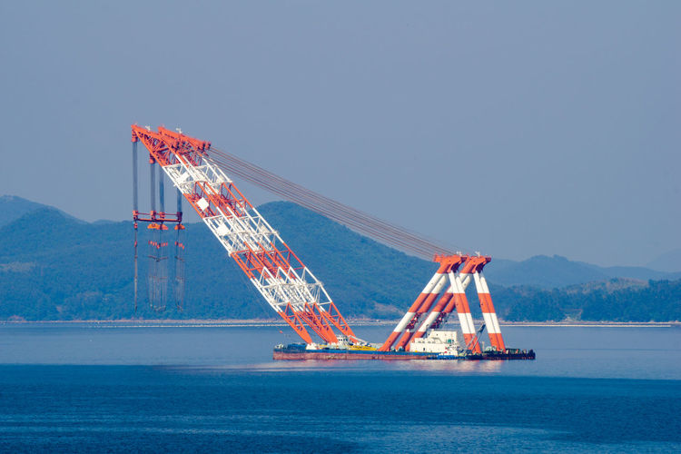 View of crane against sky