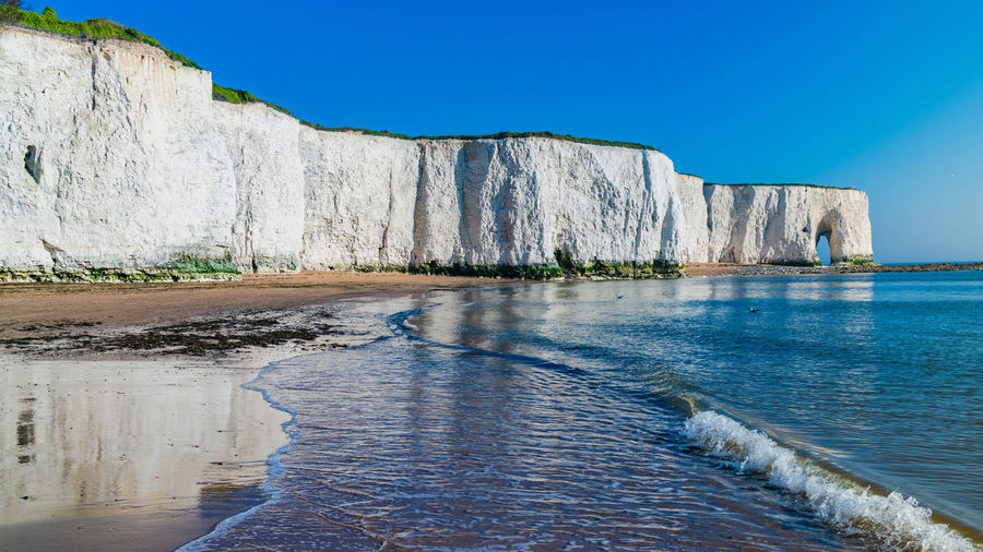 View of white cliffs and beach in Kingsgate Bay, Margate, East Kent, UK Chalk Cliffs Margate Beach Beauty In Nature Blue Clear Sky Cliff Day Eroded Flowing Water Kingsgate Bay Land Nature No People Outdoors Rock Rock - Object Rock Formation Scenics - Nature Sea Sky Solid Tranquil Scene Tranquility Water