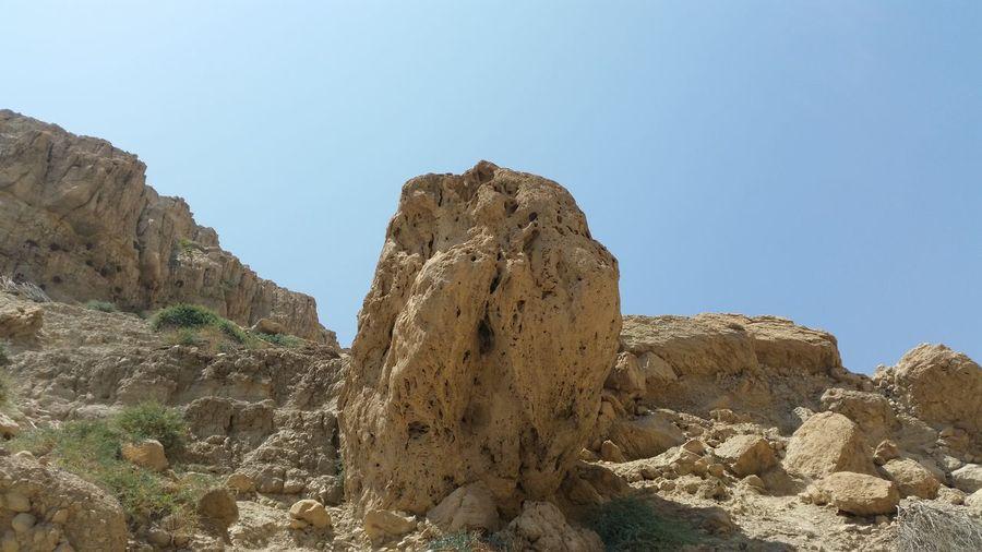 Rock formation against clear sky at ein gedi