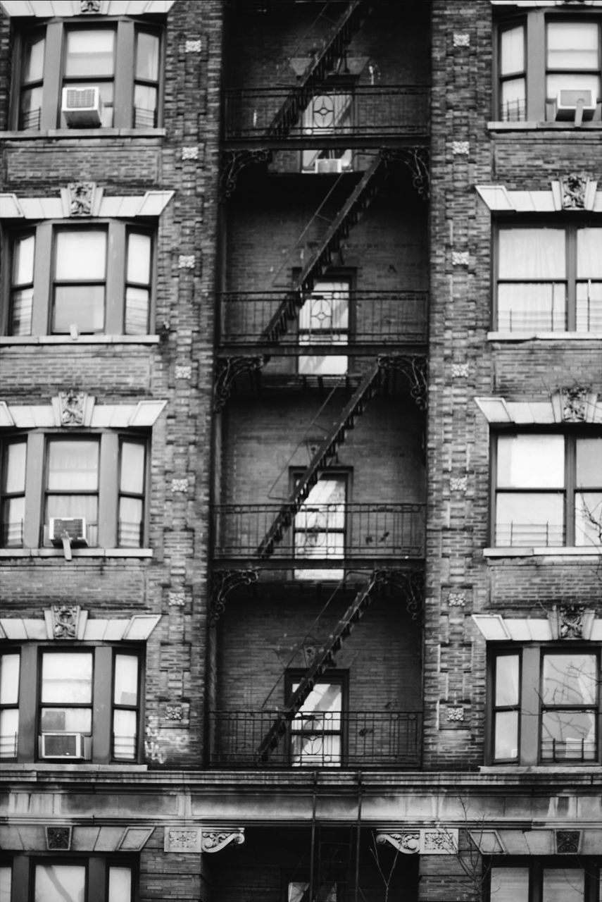 architecture, built structure, building exterior, building, window, residential district, fire escape, no people, old, day, staircase, outdoors, accidents and disasters, railing, steps and staircases, safety, abandoned, full frame, emergency exit, damaged, deterioration, apartment