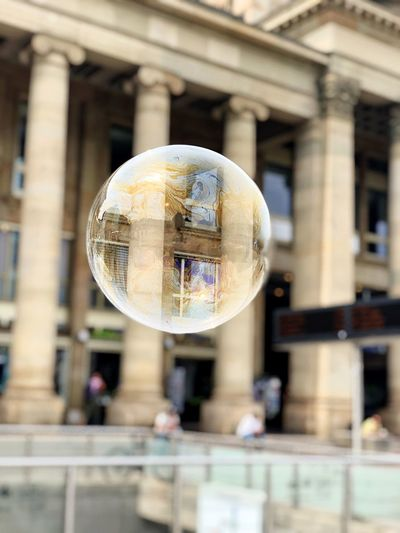 Close-up of bubbles in glass building
