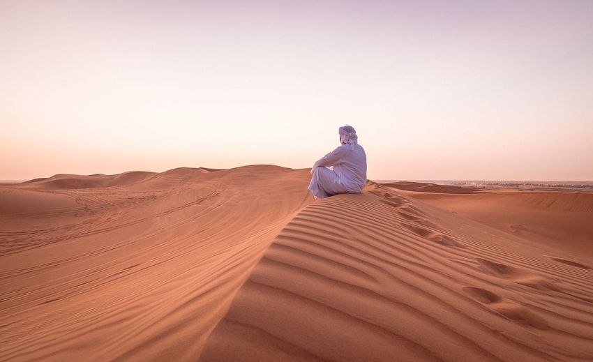 Land Sand Desert Beauty In Nature Scenics - Nature Sky Tranquil Scene Landscape One Person Clear Sky Sand Dune