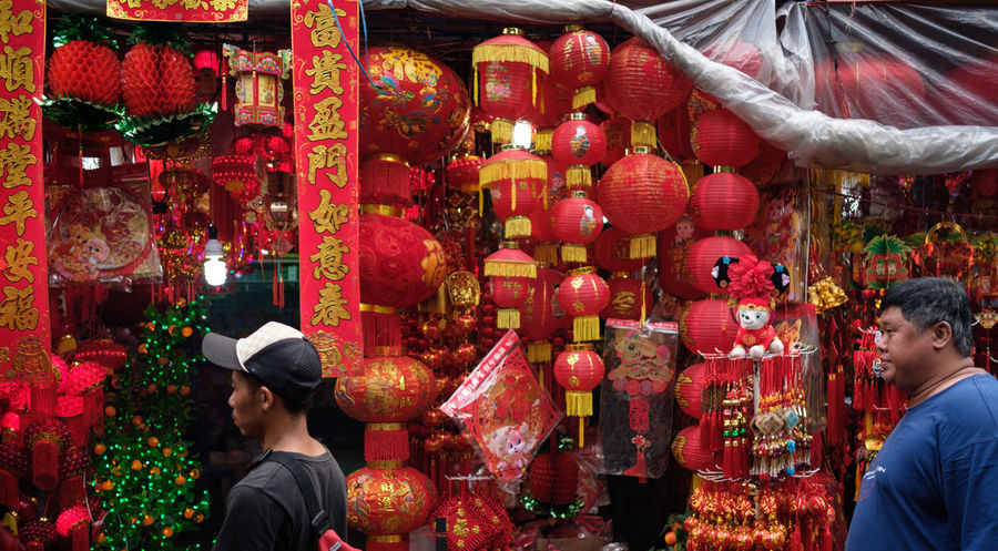 full of chinese new year decoration Chinese Tradition Chinese Traditional Style Chinese Traditional Culture Adult Adults Only Art Celebration Chinese Lantern Chinese New Year Day Decoration Hanging Lantern Men Outdoors People Real People Red Togetherness Two People Women Young Adult Young Women