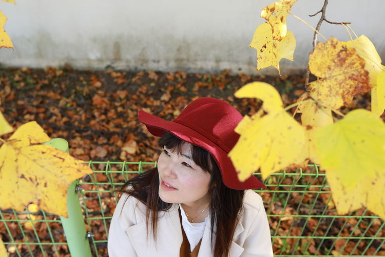 Portrait of woman wearing hat with leaves