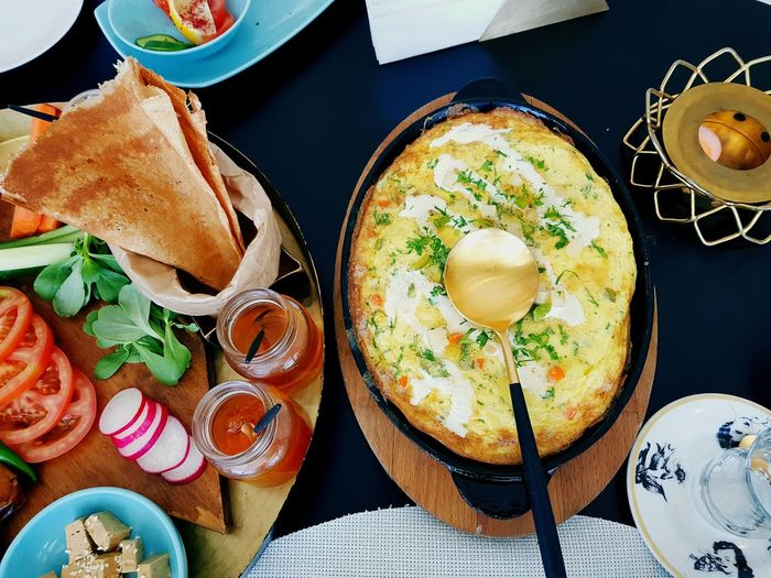 Breakfast is the most important meal of the day. When you feed yourself what your body needs when it needs it, that's love. I think its important to start the day with a proper breakfast and that has to be eggs! I love it! ☀️📷🍽☕🍳🥘🍞❤ #eggs #arabicomelette #breakfast #beautiful #restaurant #husband #friends #photography #EyeEmNewHere EyeEm Selects Plate Drink Table SLICE Food And Drink Brown Bread