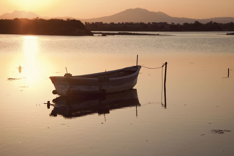 Beauty In Nature Day Moored Mountain Nature Nautical Vessel No People Outdoors Reflection Scenics Silhouette Sky Sunset Tranquil Scene Tranquility Transportation Water Waterfront